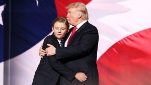 CLEVELAND, OH - JULY 21: Republican presidential candidate Donald embraces his son Barron Trump after he delivered his speech on the fourth day of the Republican National Convention on July 21, 2016 at the Quicken Loans Arena in Cleveland, Ohio. Republican presidential candidate Donald Trump received the number of votes needed to secure the party's nomination. An estimated 50,000 people are expected in Cleveland, including hundreds of protesters and members of the media. The four-day Republican National Convention kicked off on July 18. (Photo by John Moore/Getty Images)