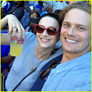 Caitriona Balfe and Sam Heughan catch rugby game together