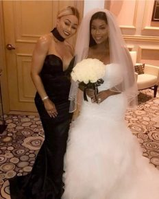Blac Chyna spotted at her Friend Kendra Cooksey's wedding in Las Vegas; Wears Revealing Black Gown in the ceremony