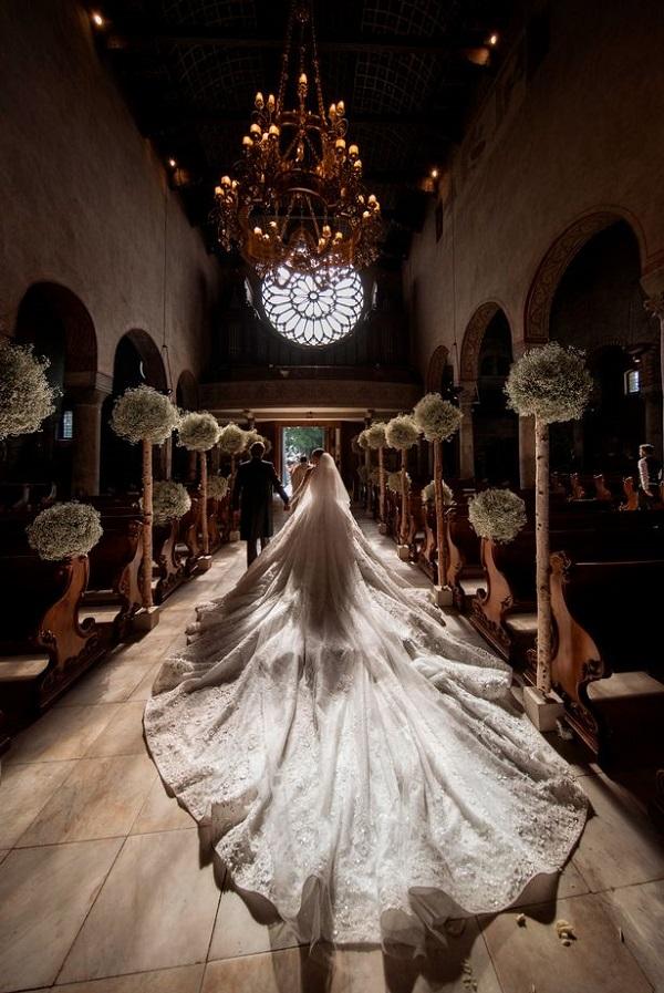 Source: Mirror (Searovski's dress had 500,000 Swarovsji crystals embedded in it)