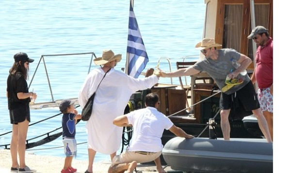 Source: Greece city times (Hugh with family going for a speedboat ride)