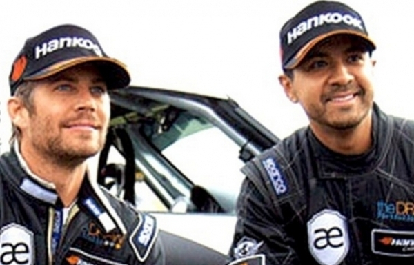 Source: Celebuzz (Paul Walker and Roger Rodas)