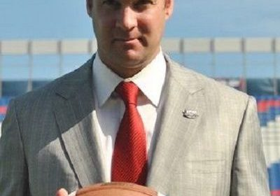 American football coach and former quarterback, Kliff