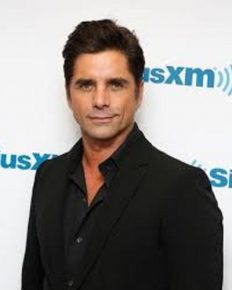 John Stamos shamed on social media for the way he was carrying his infant in the baby carrier! Know what he expert says!