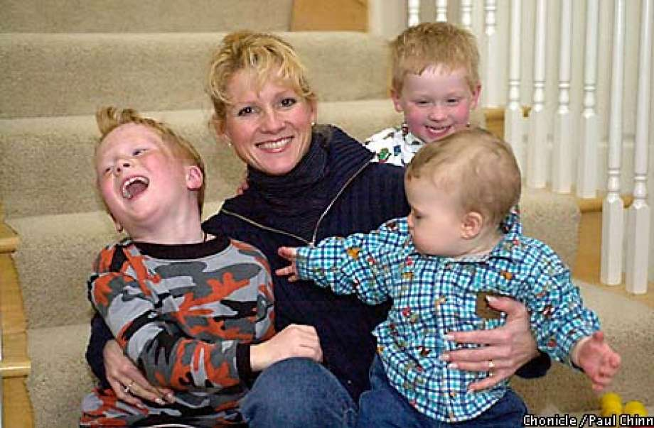 Cindy Gruden with her three children