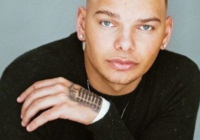 Raised by his single mother and all the hardship during his early days, Kane Brown has established himself as a successful country singer and songwriter!