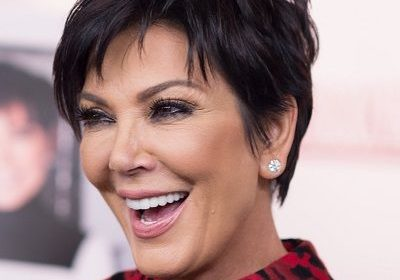 Kris Jenner trips and almost falls during an on-stage appearance for the YouTube Creator Summit