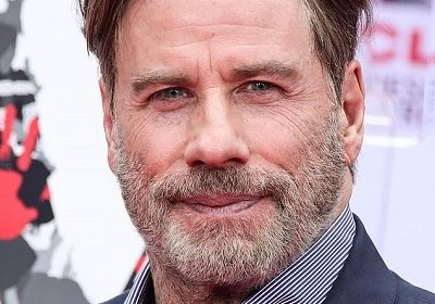 What and who is the reason behind the bald head of John Travolta?