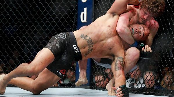Ben Askren chokes Robbie Lawler in their welterweight mixed martial arts bout at UFC 235
