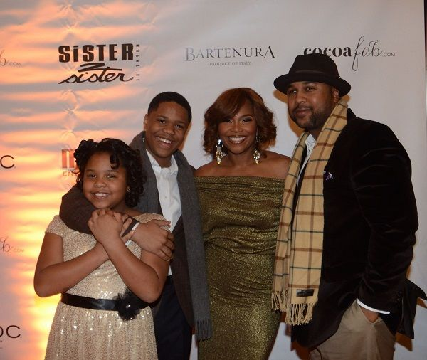 Mona Scott Young with her husband and children