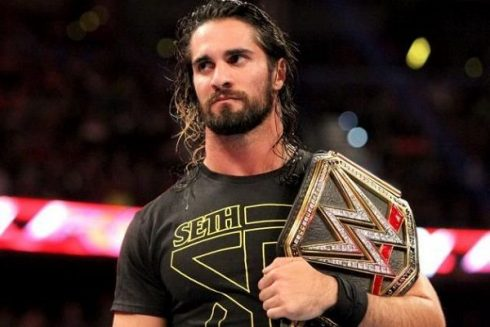 Seth Rollins in ring with belt during event at Barclays