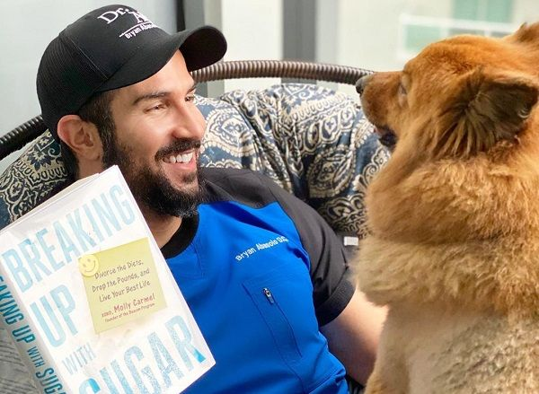 Bryan Abasolo with a dog
