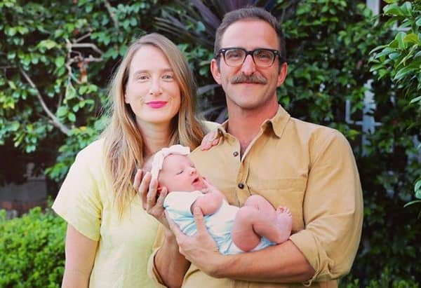 Niki Schwartz-Wright and Will Greenberg with their daughter