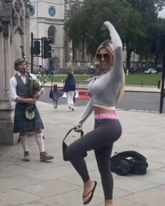 Chloe Ferry highland dances to the tune of a busking piper on London Street on her wild birthday celebrations!